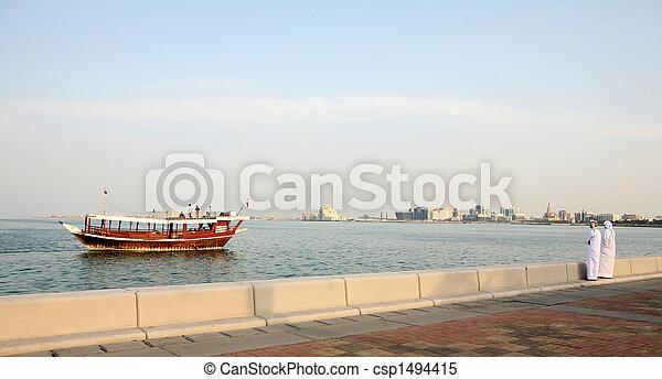 Doha Corniche locals and boat - csp1494415