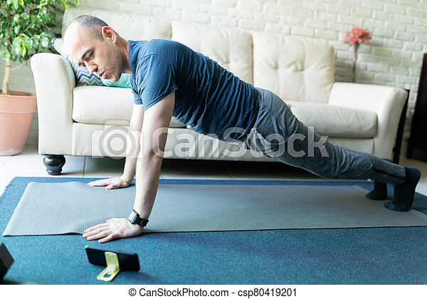 Doing an online exercise routine on a phone - csp80419201