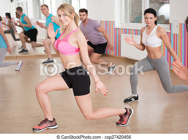 Doing squats at the gym - csp27420456