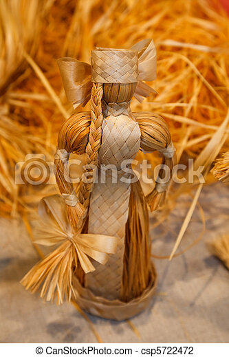 Doll woven from straw. Antique toys, souvenirs. Close-up. - csp5722472