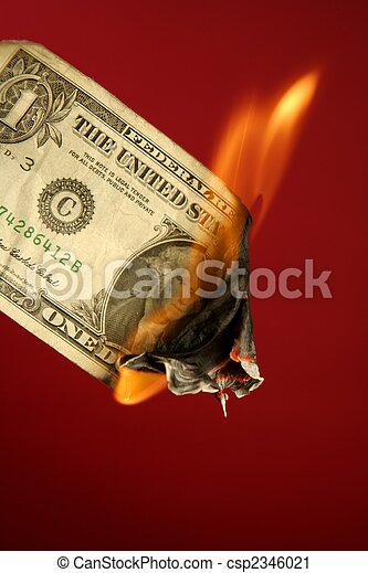 Dollar note burning in fire over red - csp2346021