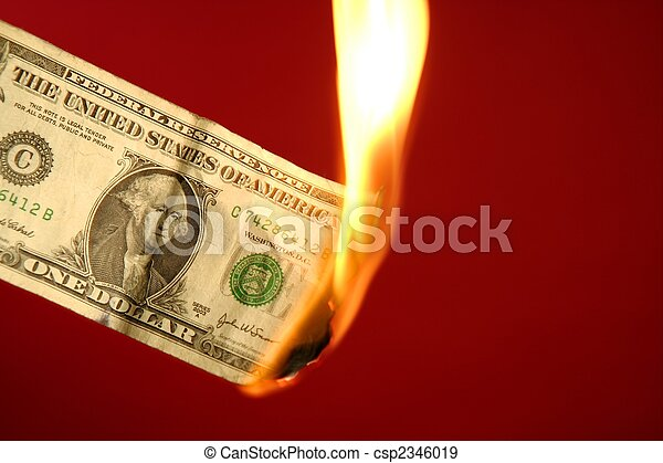 Dollar note burning in fire over red - csp2346019