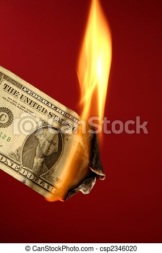Dollar note burning in fire over red - csp2346020