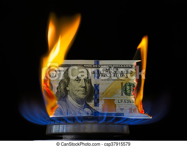 Dollar on fire in gas burner flame. - csp37915579