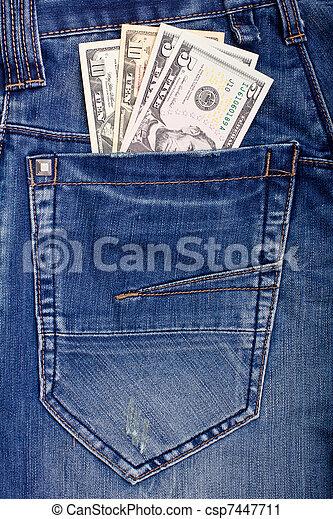 Dollars in blue jeans pocket - csp7447711