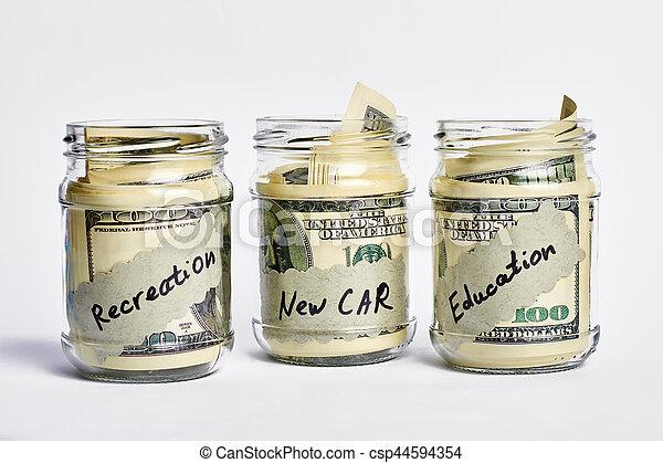 Dollars in money jars. - csp44594354