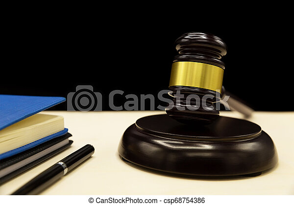 Domestic violence law on a wooden table. - csp68754386