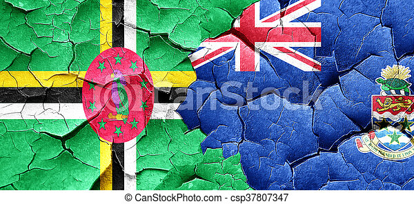 Dominica flag with Cayman islands flag on a grunge cracked wall - csp37807347