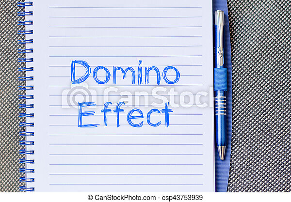 Domino effect concept on notebook - csp43753939