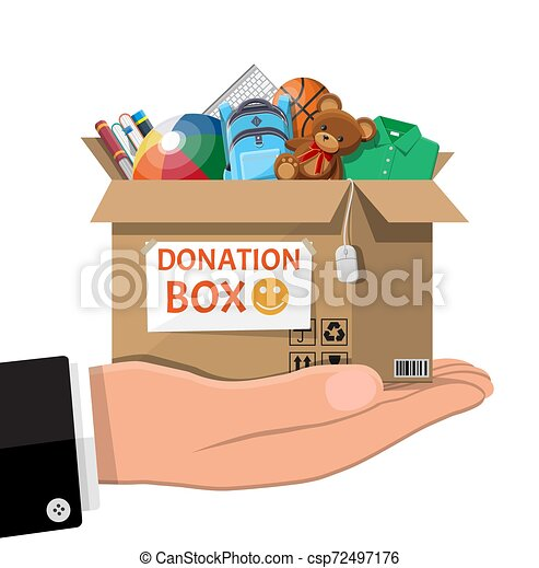 Donation box full of toys, books, clothes, devices - csp72497176