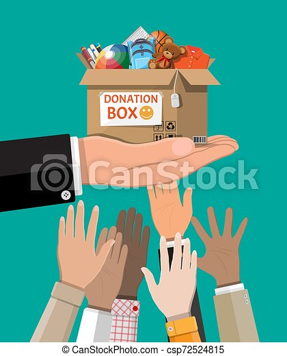 Donation box full of toys, books, clothes, devices - csp72524815