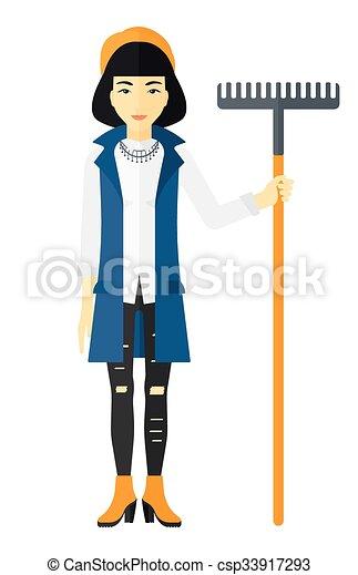 donna, rake., standing - csp33917293