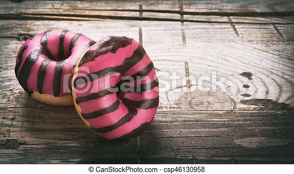 Donut on a wooden table - csp46130958