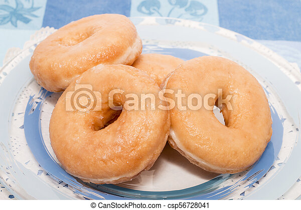Donuts on a plate - csp56728041