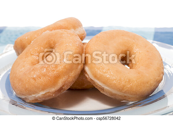 Donuts on a plate - csp56728042