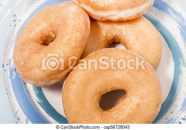 Donuts on a plate - csp56728043