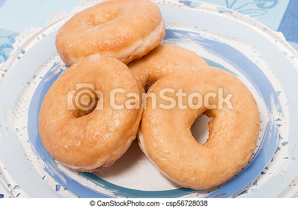 Donuts on a plate - csp56728038