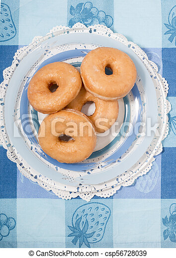 Donuts on a plate - csp56728039