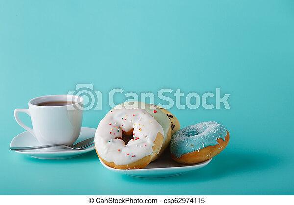 Donuts on aquamarine background - csp62974115