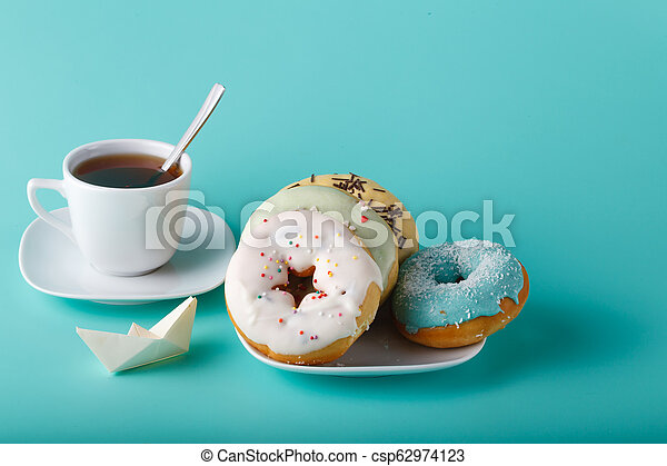 Donuts on aquamarine background - csp62974123