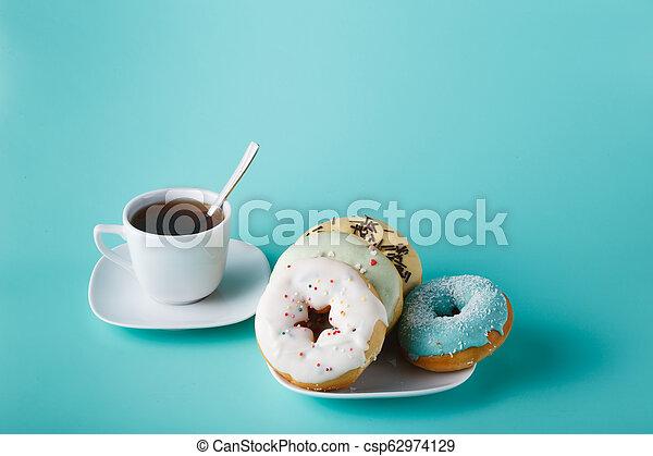 Donuts on aquamarine background - csp62974129