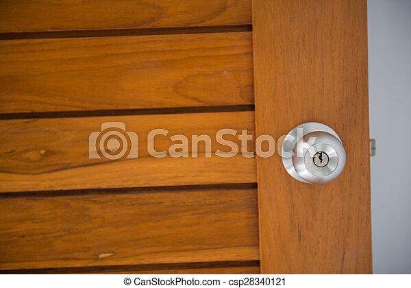doorknob on the wood door  - csp28340121