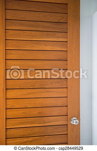 doorknob on the wood door - csp28449529