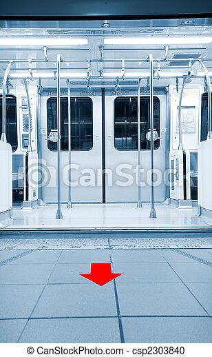 doors opened in metro station with arrow - csp2303840