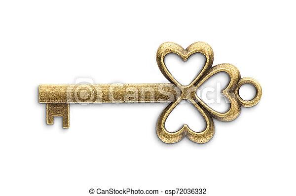 Una antigua llave maestra de oro aislada en el fondo blanco - csp72036332
