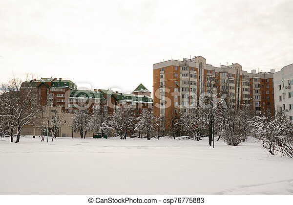 Dormitory area with residential buildings in winter - csp76775883