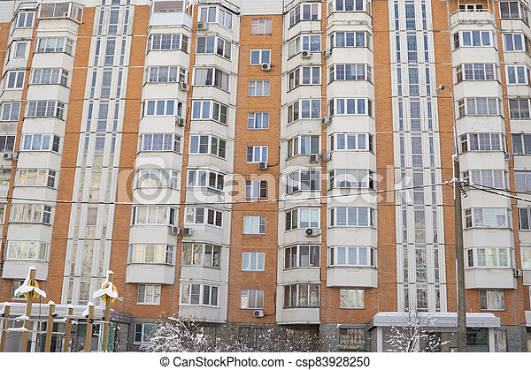 Dormitory area with residential buildings in winter - csp83928250