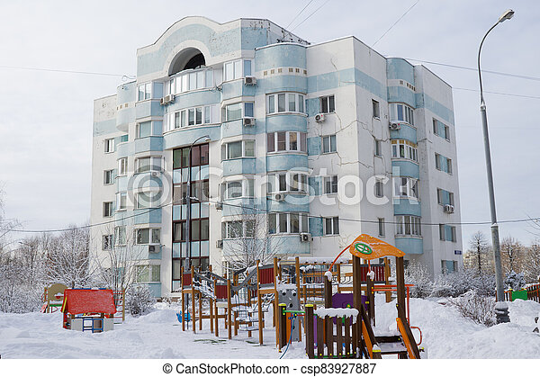 Dormitory area wth residential buildings in winter - csp83927887