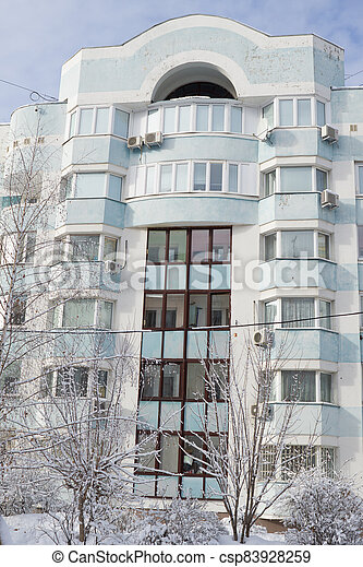 Dormitory area wth residential buildings in winter - csp83928259