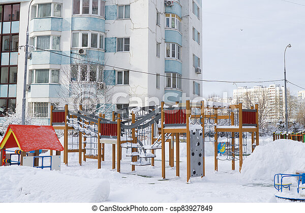 Dormitory area wth residential buildings in winter - csp83927849