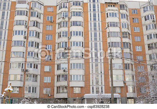 Dormitory area wth residential buildings in winter - csp83928238