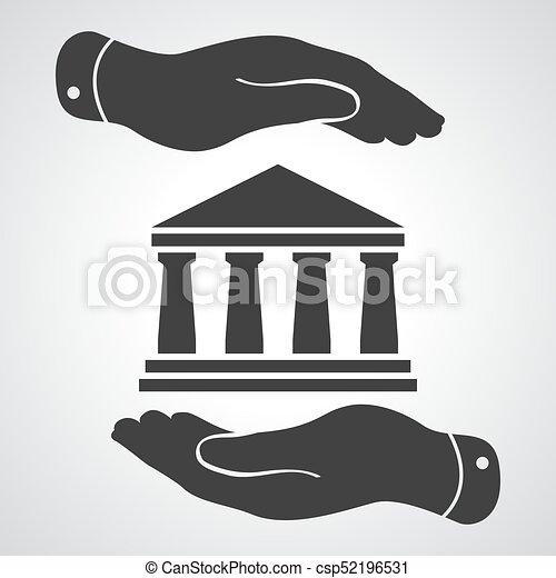 Dos manos con placa con icono del banco negro en un fondo gris - csp52196531