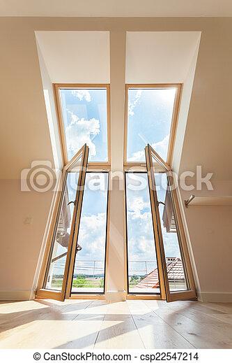 Double balcony window in the attic - csp22547214