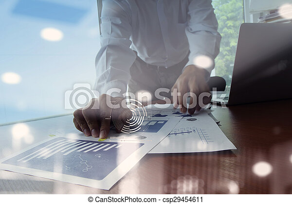 Double exposure of businessman hand working with new modern computer and business strategy as concept - csp29454611