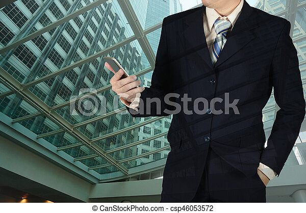 db959ee58774b Double Exposure Of Businessman Holding Smart Phone With Blurred Building  Background.