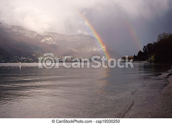 Double rainbow sky on Annecy lake, France - csp19330250