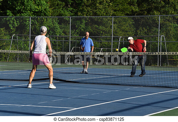 Doubling up to Play Pickle Ball - csp83871125