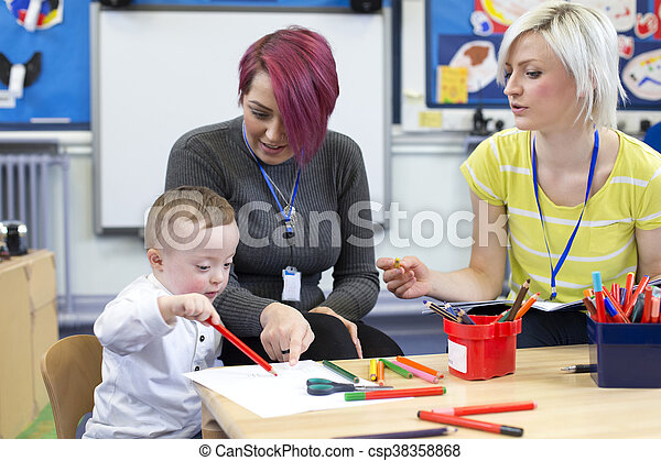 Down Syndrome boy at Nursery - csp38358868