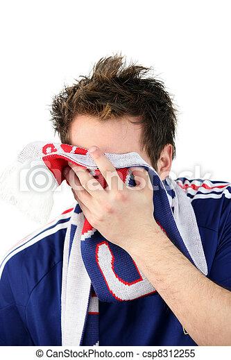 Downcast French football fan - csp8312255