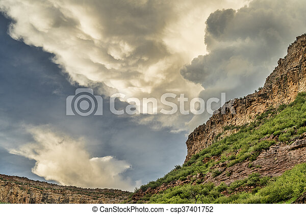 Dramatic clouds over sandstone clif - csp37401752