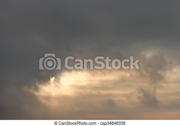 Dramatic cloudscape with reddish sun - csp34848336