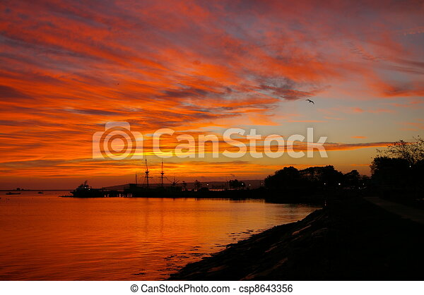 Dramatic Coastal Sunset - csp8643356
