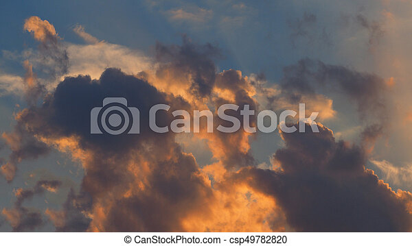 dramatic orange blue clouds sky background - csp49782820