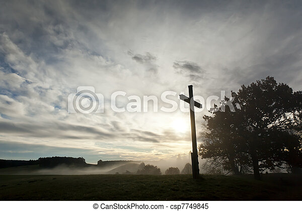 dramatic sky and a cross - csp7749845