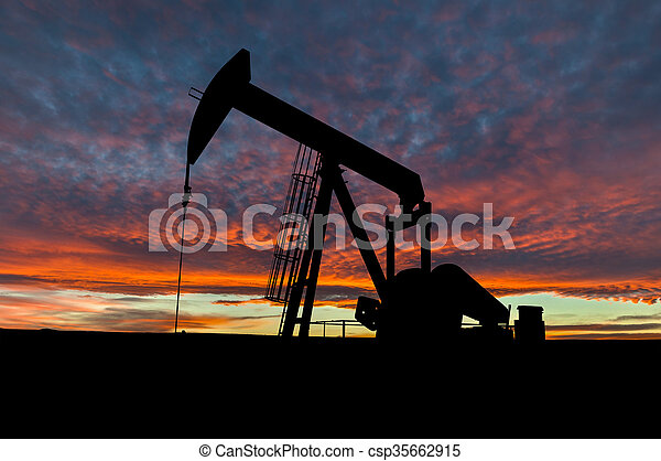 Dramatic Sky Over Pumpjack Silhouette in Rural Alberta, Canada - csp35662915