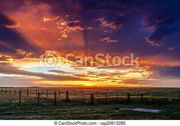 Dramatic Sunset Over Prairie - csp20613285